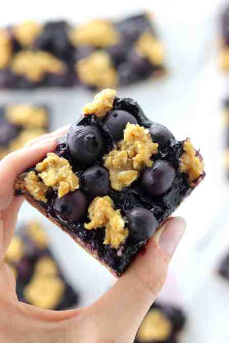 holding blueberry crumble bars