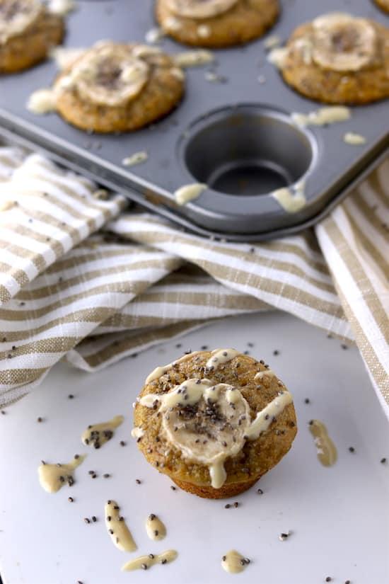 chia tahini banana mini muffins out of tin on counter
