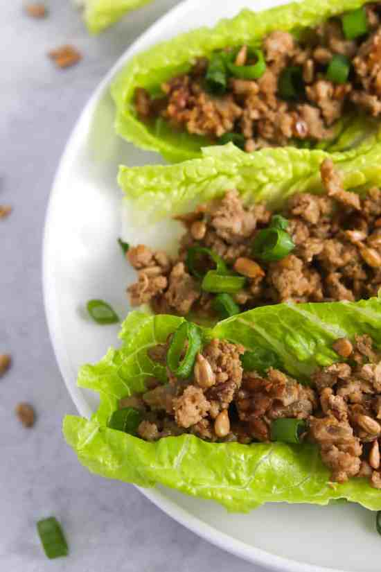 These easy, healthy & freezer friendly chicken lettuce wraps will become a weeknight staple! The secret ingredient (SunButter!) gives them AMAZING flavor you won't be able to get enough of! #easyrecipes #dinnerrecipes #freezerfriendly #weeknightmeal