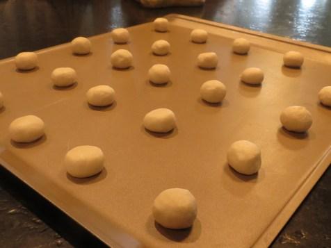 Raw dough balls, slightly flattened.
