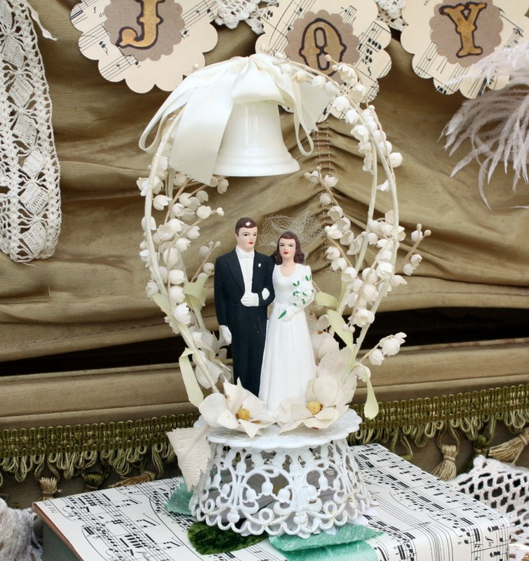 Charming Vintage Wedding Cake Toppers   Mitzi s Miscellany Wedding cake toppers are easy to find at estate sales  because who would  throw away the most important memento from their wedding