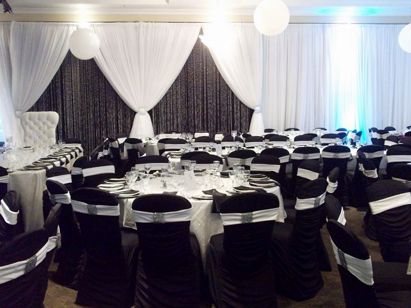 This modern wedding reception featured black and white tables, chairs, and decor