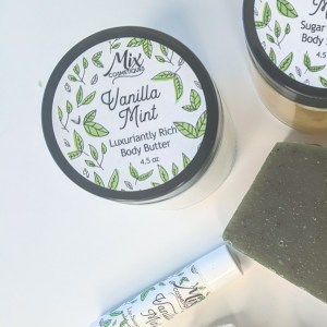 Vanilla Mint Luxuriantly Rich Body Butter pictured with Vanilla Mint Body Polish, Handmade Bar Soap and Lip Balm