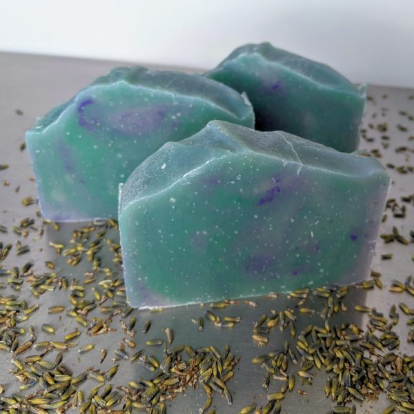 Green and purple handmade soap with lavender and tea tree, lavender buds three bars of soap