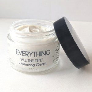 showing everything all day optimizing cream in open jar