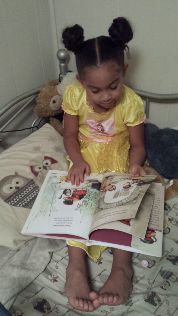 La Princesa and the Pea - Book Review by Mixed Family Life - daughter reading book