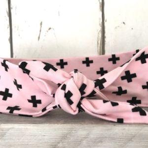 Roze haarbandje met zwarte plusjes