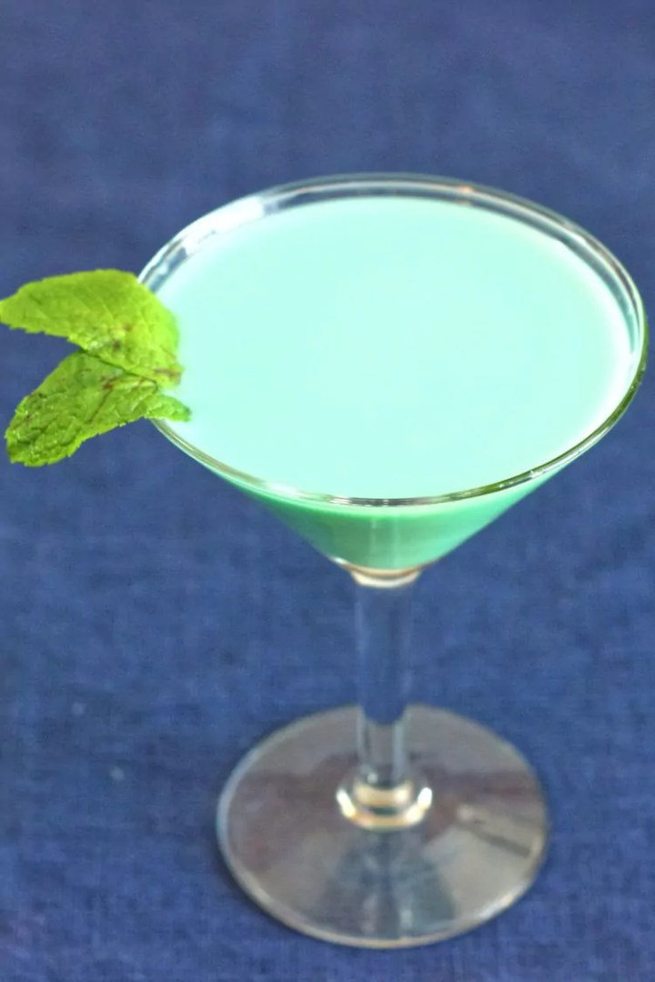Creamy green Grasshopper drink with mint sprig
