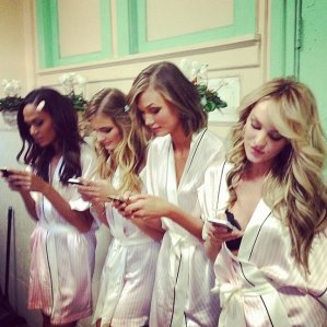 Models are just like us, addicted to their cell phones