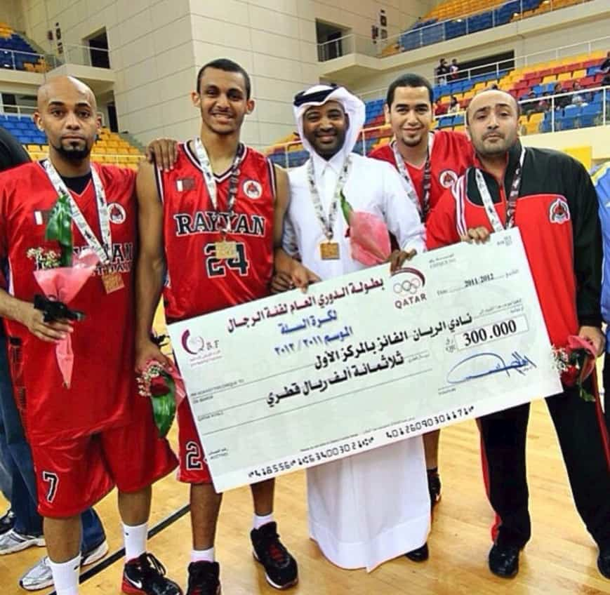 mizo amin and team manager salah Ateeq holding a 300000 QR Check after wining the leauge