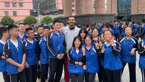 mizo amin with some basketball fans at china