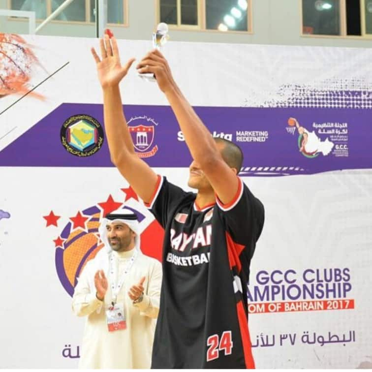 Mizo Amin holding best 3 point shooter in the gulf region trophy