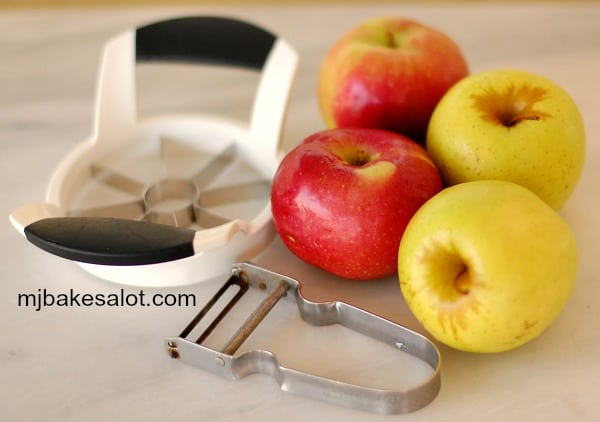 Fresh apples and the tools used to prepare them for the honey apple Bundt cake. | mjbakesalot.com