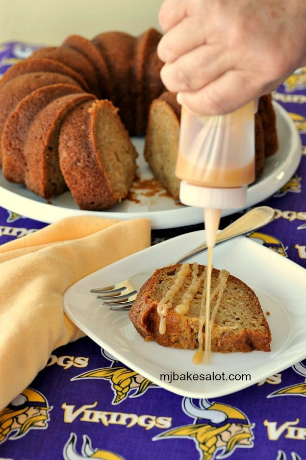 Apple caramel sauce drizzled on a slice of honey apple Bundt cake is the delicious final touch. | mjbakesalot.com