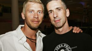 Dan Savage, right, with his husband, Terry Miller