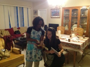 Dr Holder, showing Lilane's books to a student