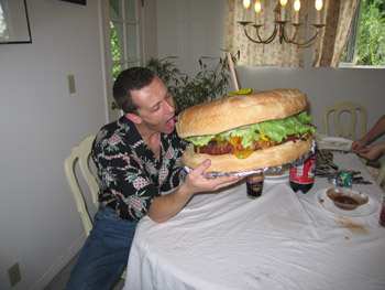 Man with giant burger...