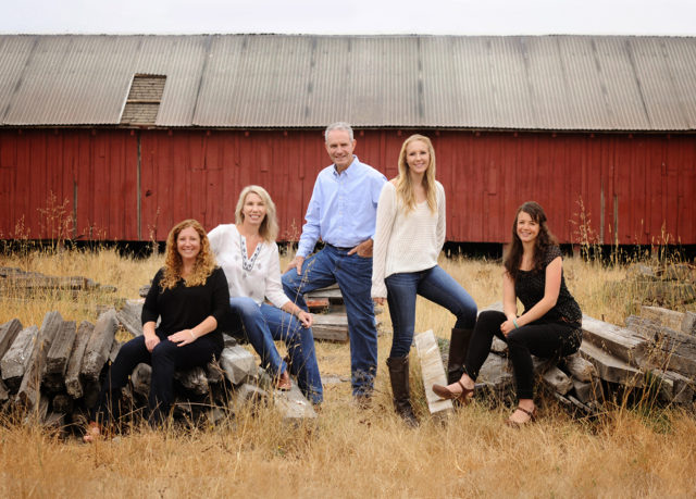 Family portrait with rustic barn
