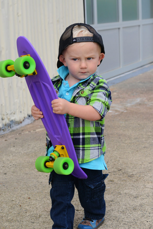 toddler with skateboard and attitude