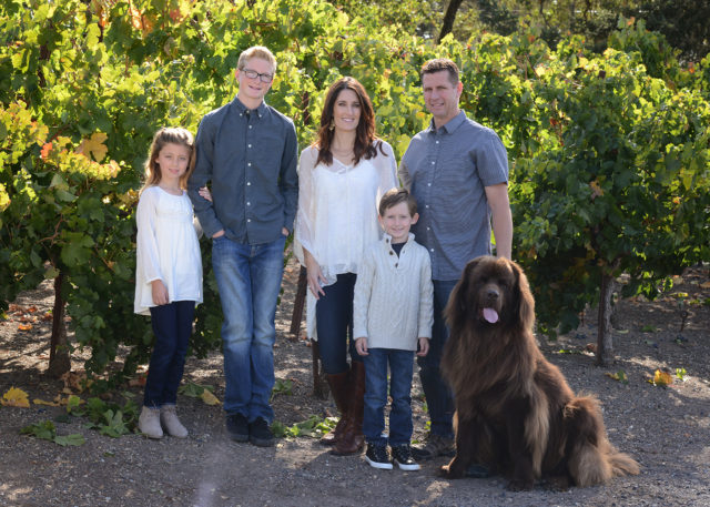 Family portrait at winery with dog