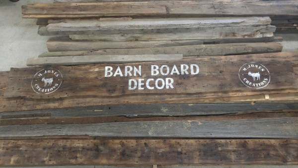 """The new barnboard """"header"""" for our outdoor booth"""