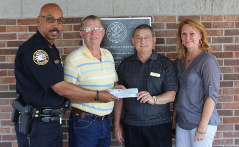 Chief James Hambrick and Joe Willoughby, Bob Carrizzo, and Carolyn Smith with the Mt. Juliet Help Center