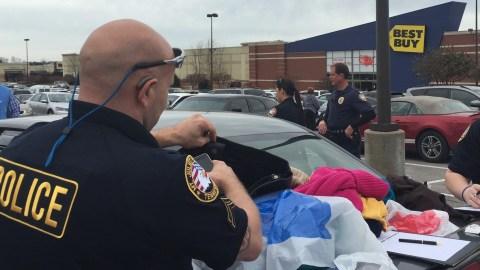 Officer Shuffles Through Stolen Clothing