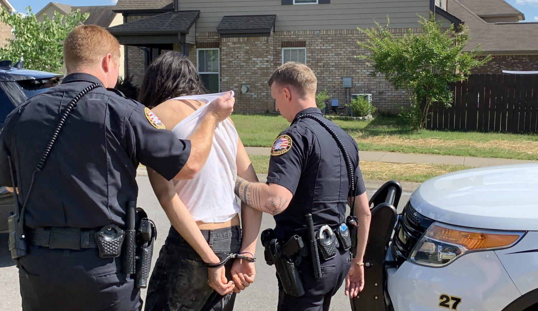 Two Officers Escort Arrestee