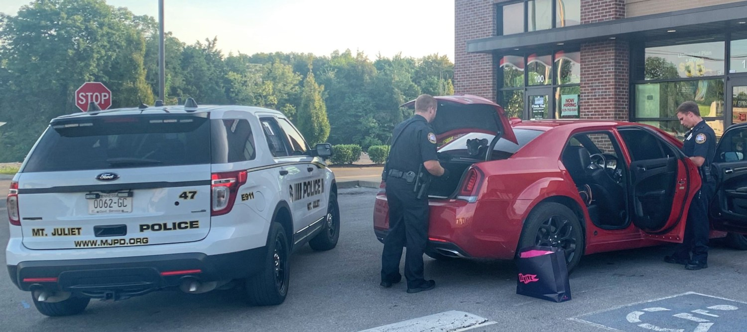 Officers Searching Vehicle Used in Theft Crime
