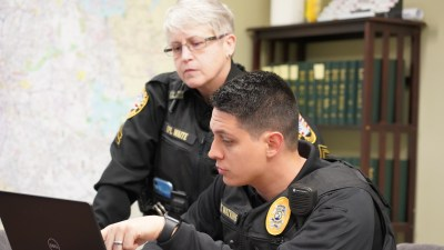Two Officers Look Over a Computer
