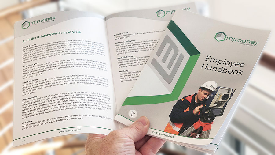 MJ Rooney hands out their Health and Safety handbook to each employee of this basement company