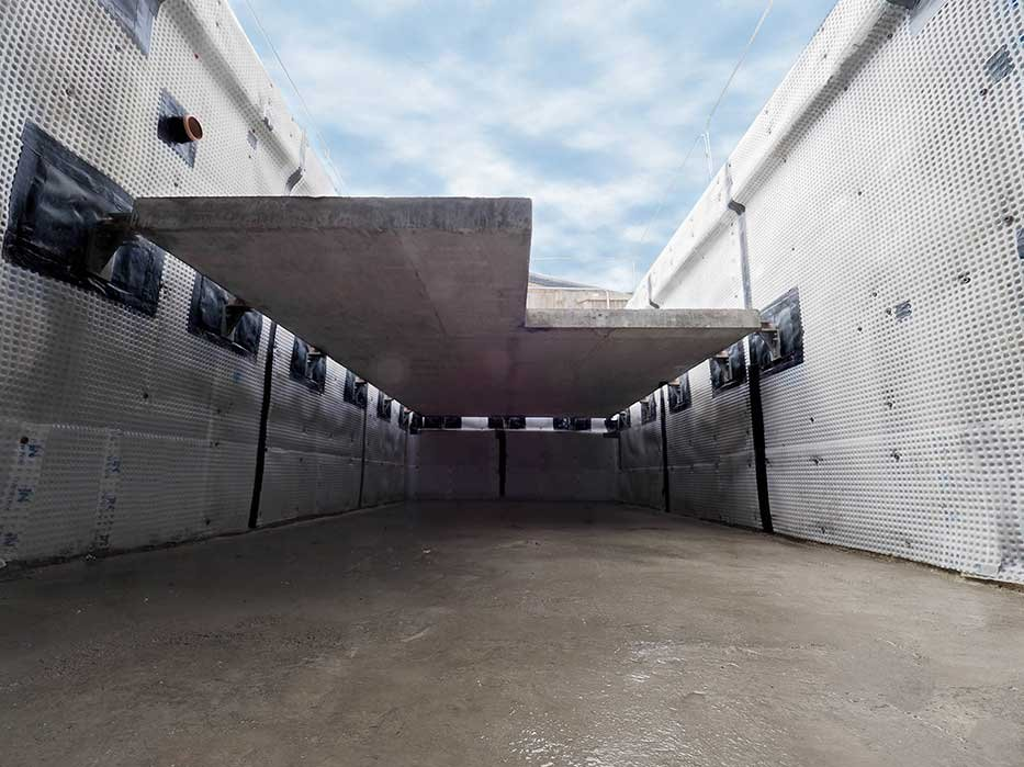 basement suspended concrete slab supported through brackets to the waterproofed walls
