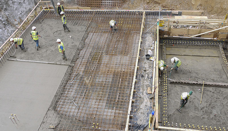 Different stages to build the foundation by pouring concrete into the basement slab