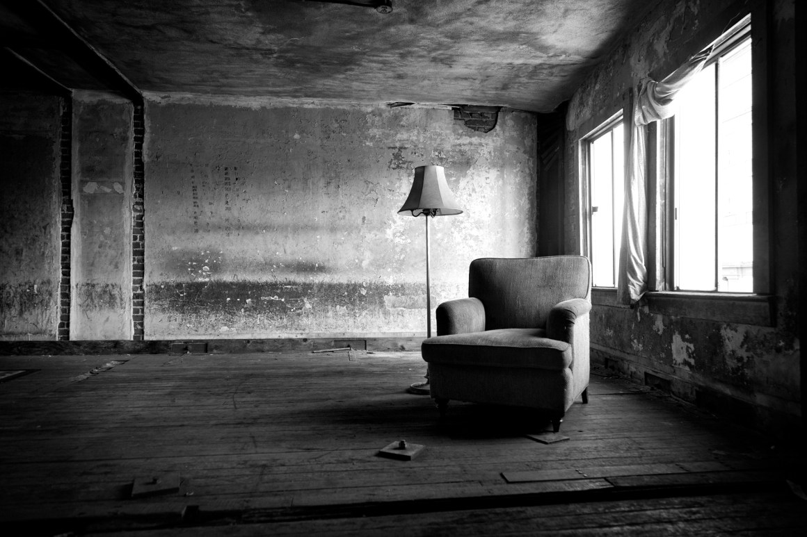 Chair in abandoned building natural light urban decay balck and whit photograph