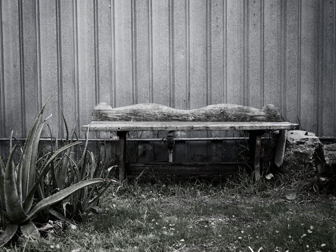 desaturated photo with wooden bench