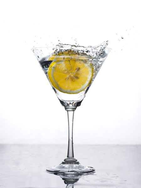 lemon wedge splashed into martini glass back lighting with eVolv200 strobes