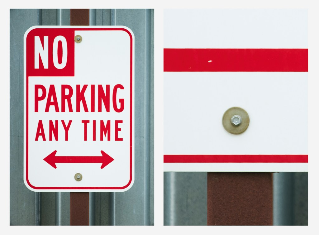 Image of no parking sign to show the sharpness of the Canon FD 500mm cropped to a screw
