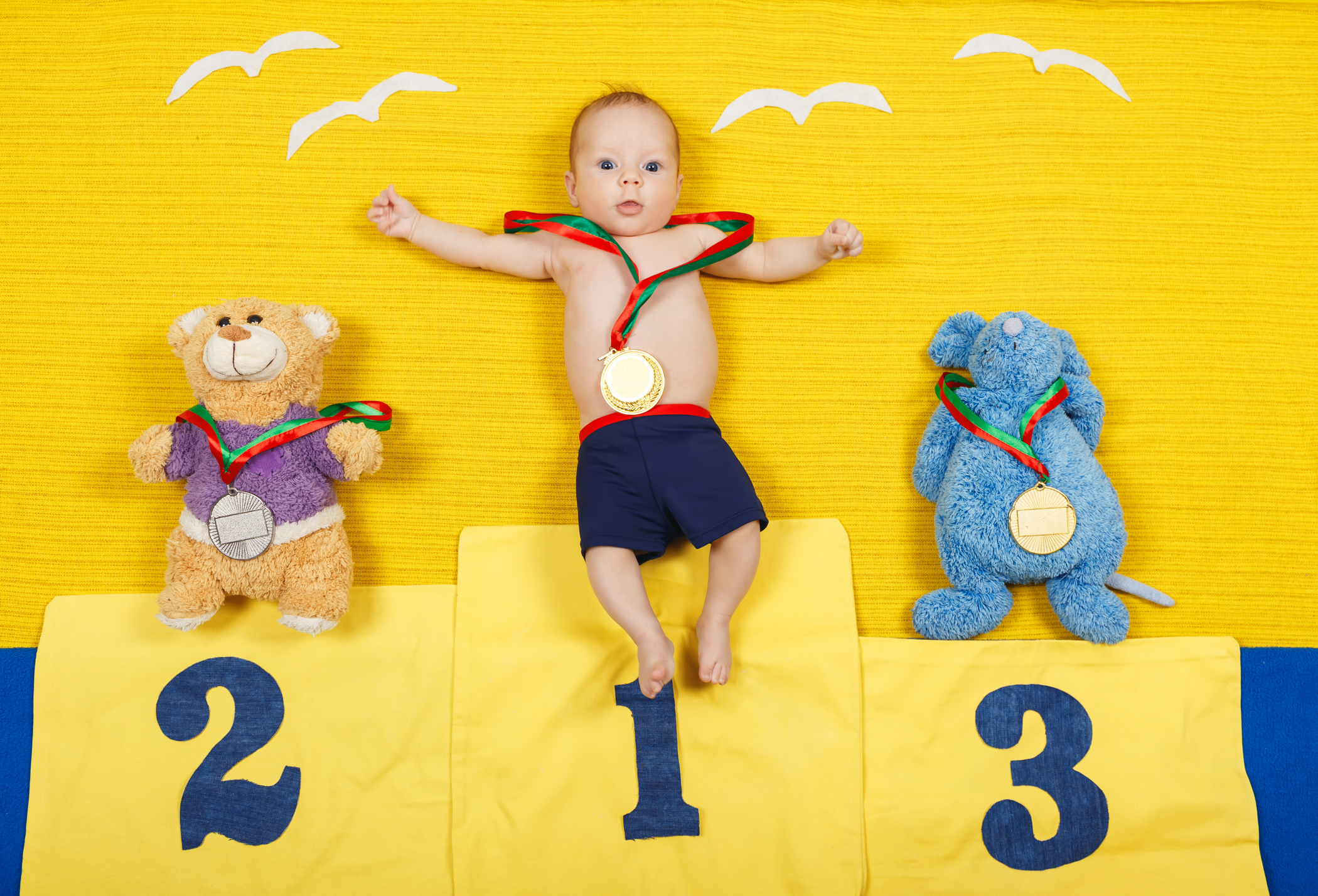 Full length portrait of a little child is standing on a place podium in first place.