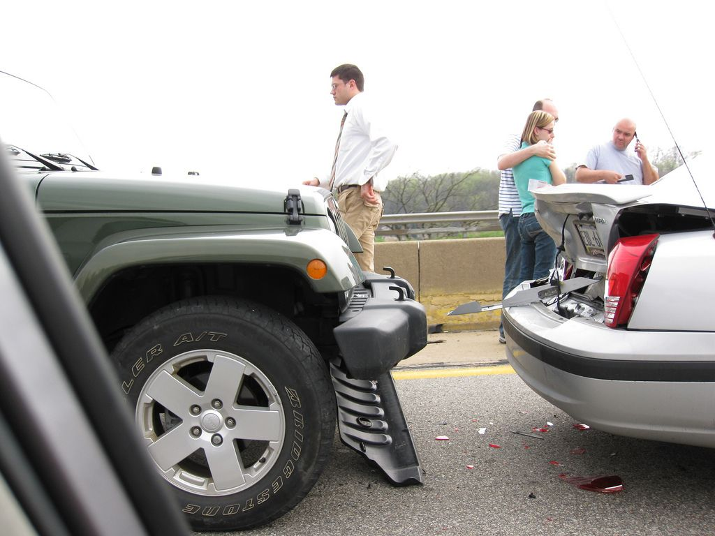 People standing next to the cars after a car accident