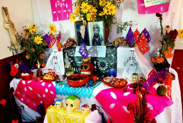 Typical Day of the Dead altar featuring favorite food and drink of the deceased.