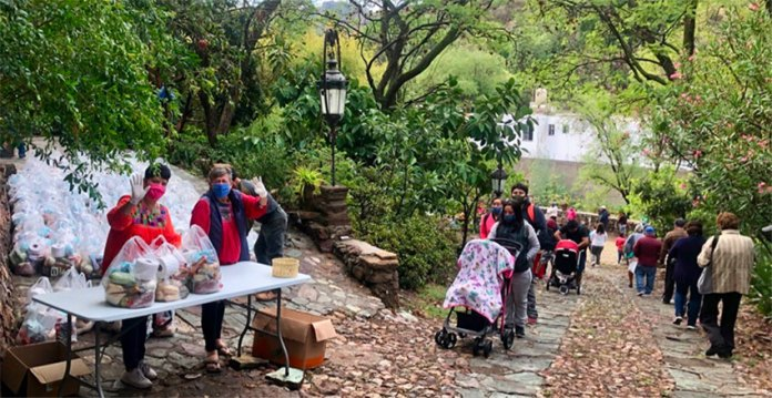 Distribution day: people line up for food and other supplies in Marfil, Guanajuato.
