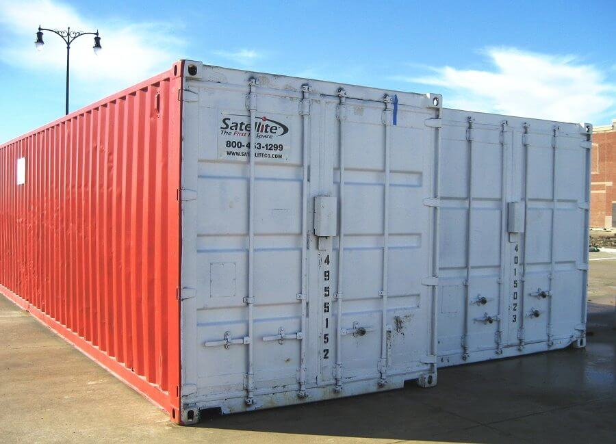 Satellite Shelters 40-foot storage containers, double doors, side by side, in parking lot