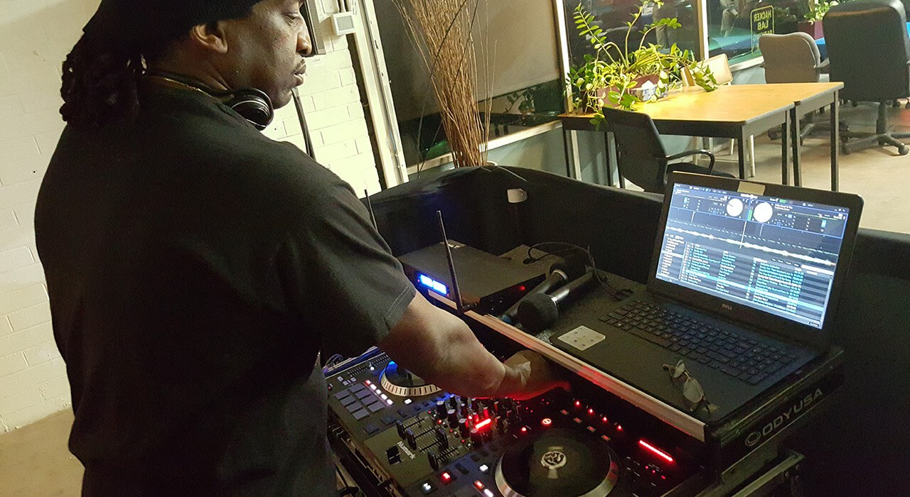 dj kamau working the music mixer