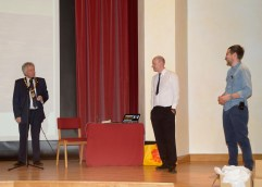 Martin Kincaid (vice-president) asks David Hopkins (Milton Keynes Mayor) to make a presentation to Roy Maycock (President)