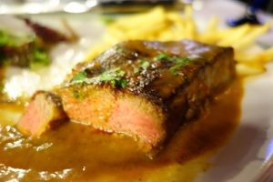 NY steak in peppercorn sauce