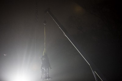 A statue of Nathan Bedford Forrest is hoisted into the air by a crane.