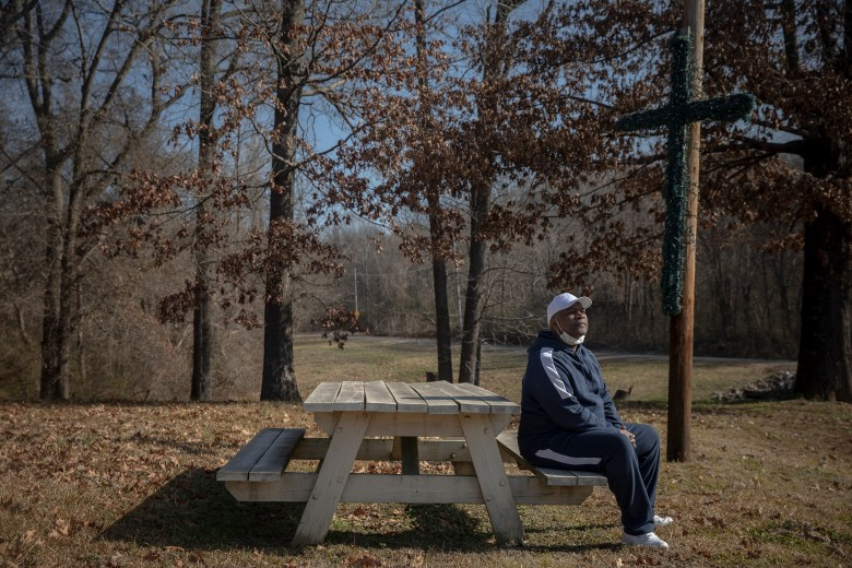 Joseph Owens sits at a picnic table on his property. Byhalia Connection Pipeline took Owens to court, claimed eminent domain and took easements.