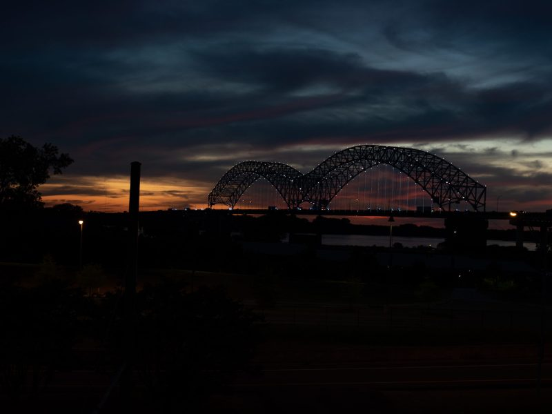 A picture of the Hernando de Soto Bridge in Memphis at sunset.