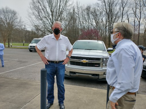 Former Vice President Al Gore speaks to Memphis City Councilman Jeff Warren in a parking lot ahead of Sunday's rally.
