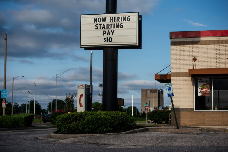 A Burger King sign advertises a $10/hour starting wage for its jobs.